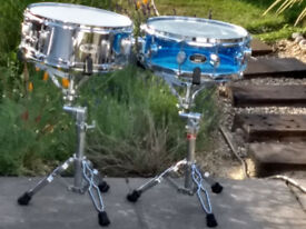 Drum Workshop Pacific Acrylic Snare (Vistalite), 14'' x 5'' as shown on right in first two picture