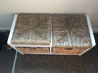 White wood storage unit with sea grass drawers and cushions