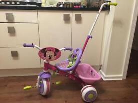 Minnie Mouse trike with push along handle