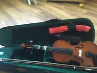 Violin with case and accessories - 1/2 size . Perfect condition.