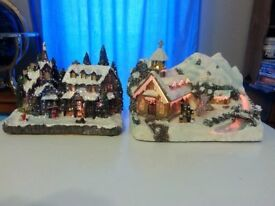electrically light up houses, various prices still on boxes. Also candle arch, also plug in.
