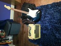 Electric guitar and amplifier (15 W)