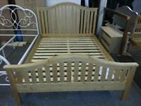 A brand new soild wood king size bed frame.