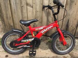 """DAWES Thunder 14"""" wheel boys bike."""