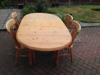 Solid pine oval extendable dining table and 4 chairs