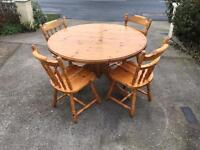Solid pine farmhouse table and four chairs