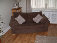 2 SEATER NEXT SOFA BROWN IN COLOUR