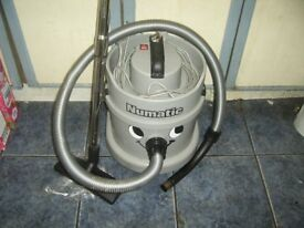 NUMATIC GREY HENRY HOOVER 1100W WITH HOSE PIPES AND FLOOR HEAD