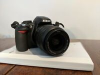 Nikon D3100 body, lens and accessories.
