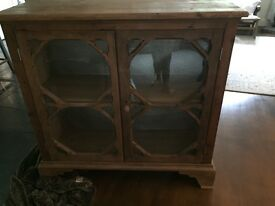 Old pine gothic style sideboard Glass fronted. 45 inches wide 43 inches high