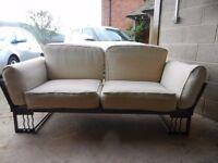 Sofa, modern metal frame and cream cushions
