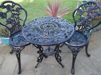 CAST IRON TABLE WITH 2 CAST IRON CHAIRS -- GARDEN SET