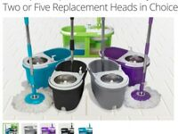 Duo spin mop and bucket with extra mop heads