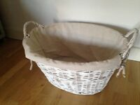 White lined rattan basket nearly new laundry toys
