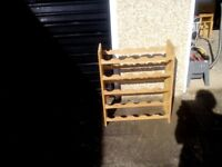 Attractive wooden wine rack that holds 25 bottles