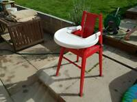 Ikea red wooden high chair.