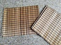 Four identical bamboo style place mats