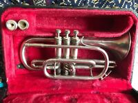 Cornet for sale, comes with two mouth peices, stand and case.