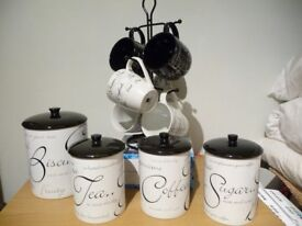 ceramic kitchen canisters tea,coffee, sugar, biscuit also mug tree all in script design very good