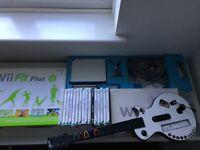 Nintendo Wii Bundle (Wii Fit + Board, Guitar Hero + Guitar, 17 Games)