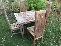 WOODEN TABLE AND FOUR HIGH BACK CHAIRS