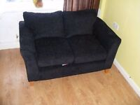 CAN DELIVER - 12 MONTHS OLD SPACE SAVER 2-SEATER BLACK SOFA IN GREAT CONDITION
