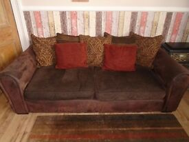 Two brown suede and fabric 3 seater sofas.