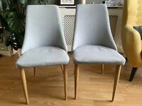 pair of grey mid-century modern chairs