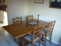 Cottage style dining table , six chairs and sidecupboard set, in light wood with carved features