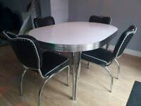 Dining table and 4 chairs. Retro American 1950's look.