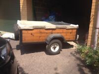 Sturdy wooden trailer in good condition with extensions.