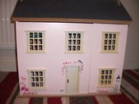 childs pink dolls house