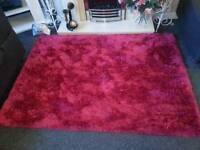 Large pink shag pile rug