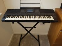 Technics KN1400 keyboard with cover and sustaining foot pedal.