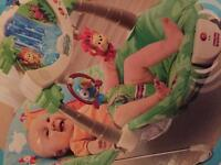 Fisher price rainforest bouncer baby chair - vibrates, animals move, waterfall lights and sounds