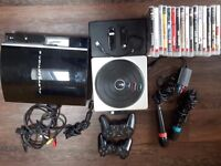 500GB Playstation 3 with 2 x Controllers 16 x Games . DJ Hero and Sing Star