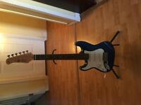 2 left handed junior guitars with 1 stand