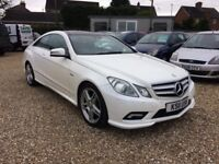 Mercedes E220 Sport Coupe. 2011 in stunning metallic white with panoramic roof.