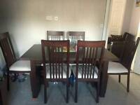 Extendable Dinning table with 6 chairs.