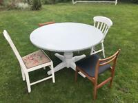 Beautiful table and 4 chairs 2 need painting all in good condition