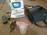 Portable dvd player with screen. All accessories and travel bag