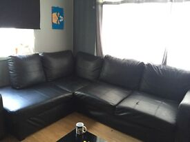 Black Leather Corner Sofa.