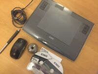 Wacom Intuos 3 graphics tablet with pen, pen stand, mouse, and replacement nibs