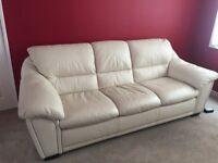 Cream leather three seater sofa