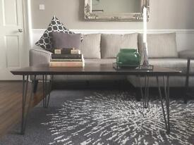 Solid coffee table with hairpin legs