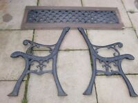 pair of Heavy cast iron bench ends with cast iron back