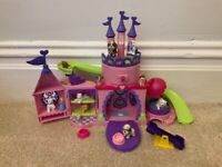 Dog castle with lots of dogs and accessories