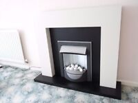 Free standing Electric fire and surround for sale.
