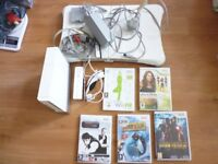 Wii Console + Board + 5 Games & Controllers