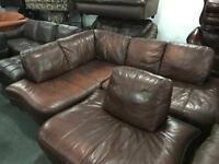 Brown leather corner sofa and matching chair